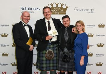 Katy Giddens, Partner at Gatenby Sanderson and actor Alexander Tulloch Macqueen with Campaigning and Advocacy winners Who Cares? Scotland