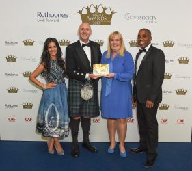 Ryan Meade, charity & commercial business development, PS Financials and journalist and broadcaster Sonali Shah present the award for Healthcare and Medical Research to the Scottish Professional Football League Trust